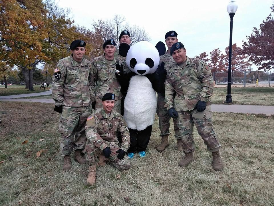 Soldiers with the Amanda Arnold Panda at Veterans Day Parade